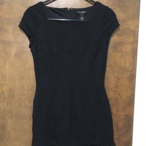 Black cap sleeve black dress with ruffle bottom